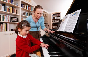 Teacher with girl pianist
